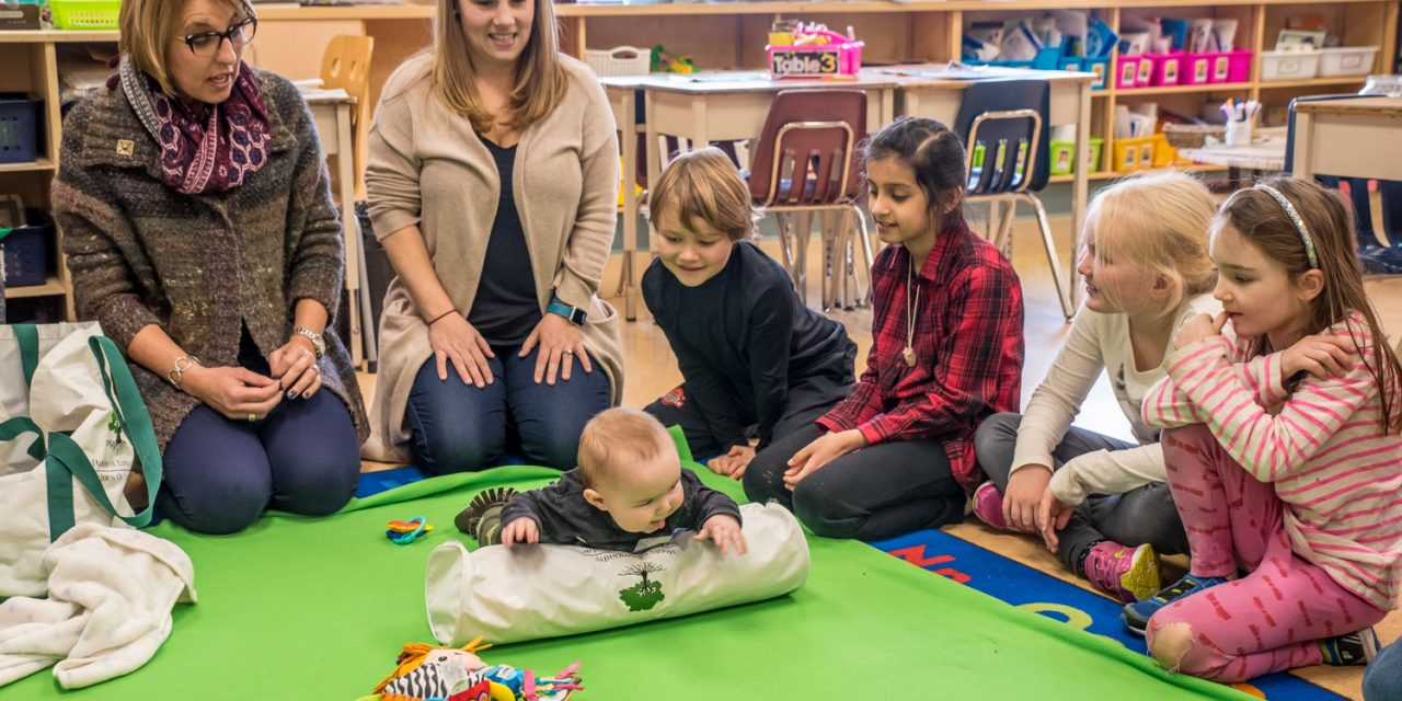 Baby's visit teaches Grade 2 children about emotions and empathy in successful Roots of Empathy program
