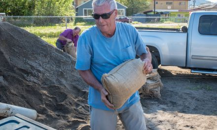 Residents fill sandbags as lake level rises sharply