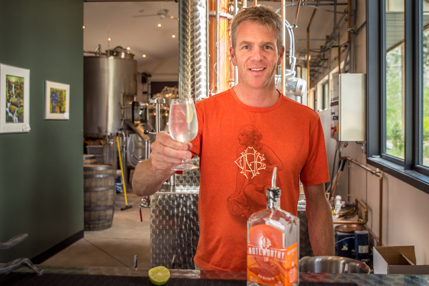 Grant Stevely, owner of Dubh Glas Distillery at Gallagher Lake north of Oliver, holds up a glass of his award-winning Noteworthy Gin. His ultimate goal, however, is to develop the best single malt whiskey in the world. (Richard McGuire photo)