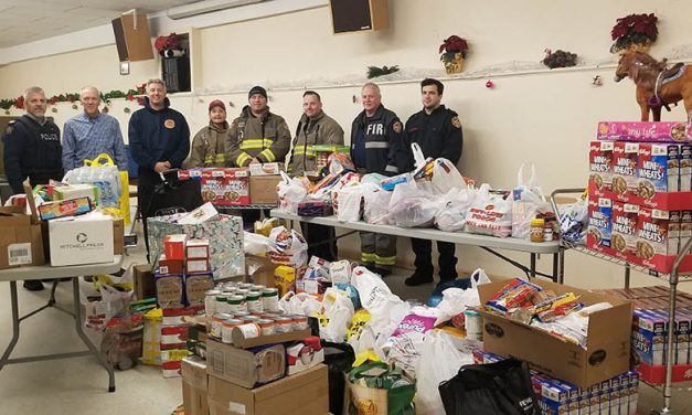 Fire Rescue collecting donations for food bank, providing new smoke alarms to residents