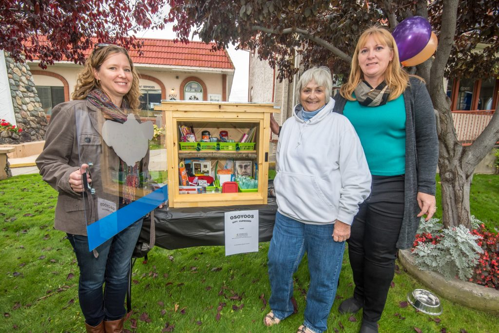 The new Osoyoos Gift Cupboard was unveiled Sunday next to the Osoyoos Art Gallery. The cupboard is expected to be mounted to a permanent stand later this week. It contains donated items ranging from toiletries to notebooks and playing cards and people will be able to help themselves to what they need. The Gift Cupboard had the unanimous support of Osoyoos Town Council and it received a $500 grant from the Community Foundation of South Okanagan-Similkameen. Pictured are the three women responsible for the project, (from left) Jen Shiels, Gaye Horn and Brenda Dorosz. (Richard McGuire photo)
