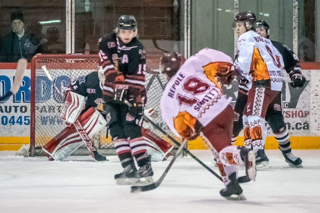 Judd Repole fired the puck through some legs in front of the net to score the Coyotes' second goal, putting Osoyoos in front 2-1. (Richard McGuire photo)