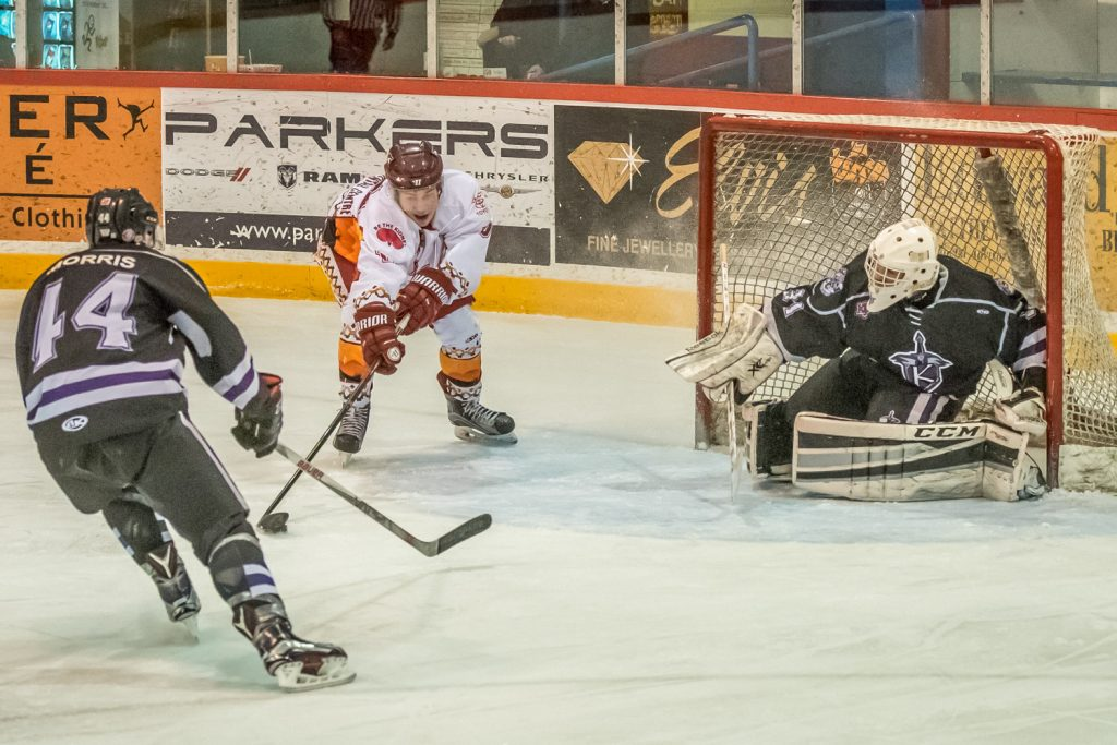 Connor Onstein gets a clear shot at the net to score the Coyotes' fourth goal in Wednesday night's 7-0 victory over North Okanagan. Their goalie Daniel Paul didn't have a chance. (Richard McGuire photo)