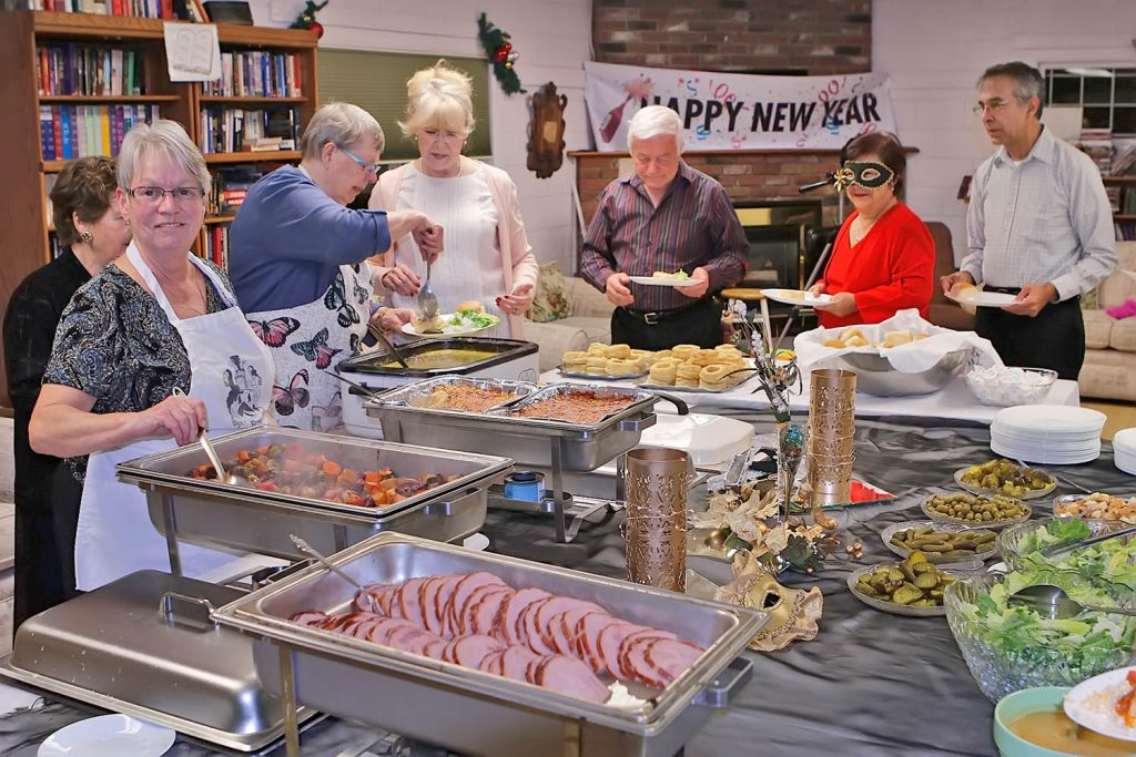 Bonnie Rhys (left) cooked most of the feast. (Colin Stark photo)