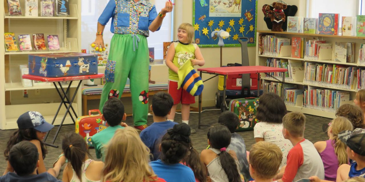 Children spellbound as clown performs at library