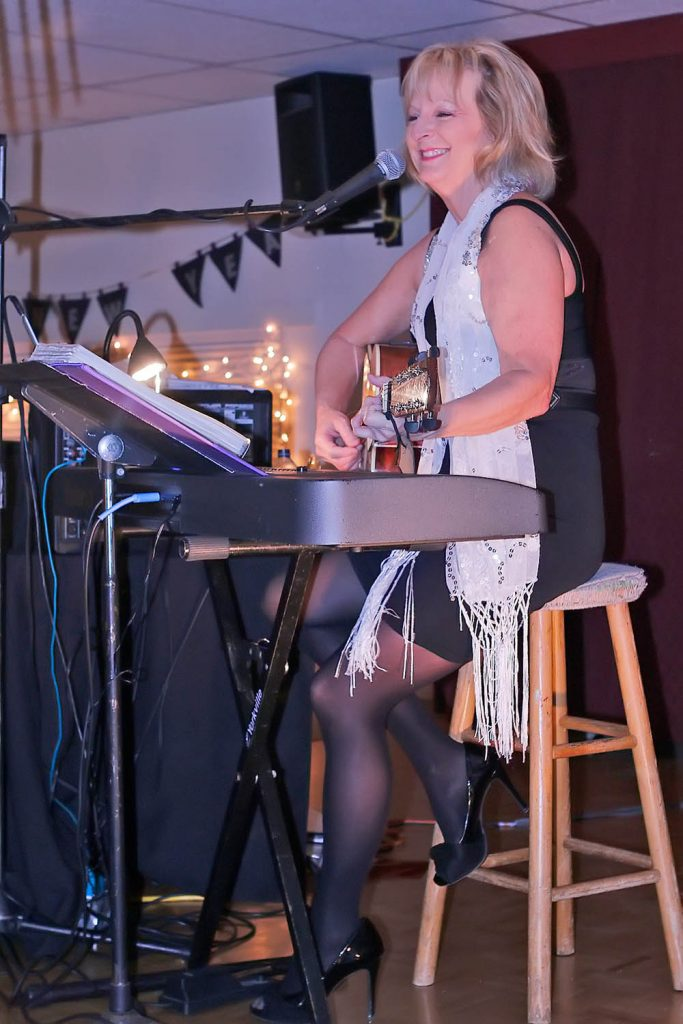 Diane Ball entertained with a guitar and keyboards. (Colin Stark photo)