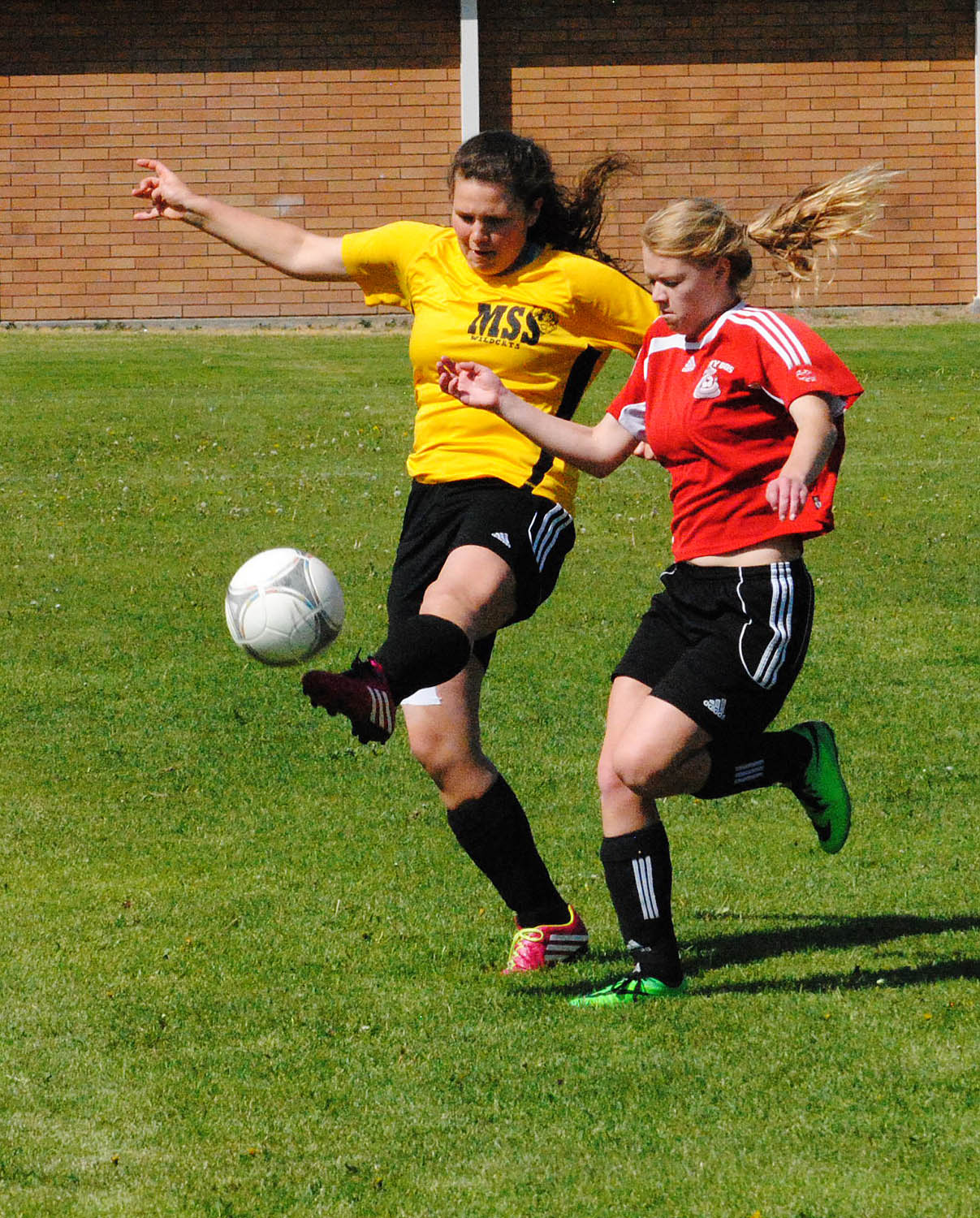 Sami Luinenberg of the Rattlers, on right, battles a Mt. Sentinel opponent for ball possession during the Rural Schools Invitational soccer tournament, held last weekend at Osoyoos  Secondary School. (Dale Corey photo)