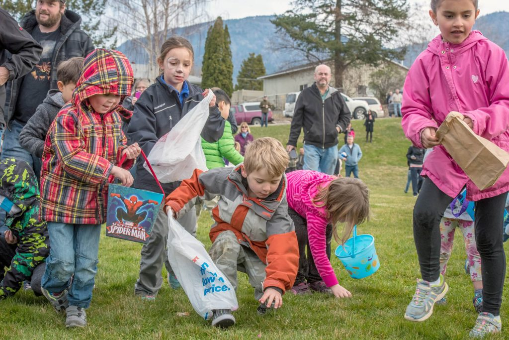 Not even a full minute elapsed when the last of thousands of candy Easter eggs were picked from the lower playground at Osoyoos Elementary School during Easter Eggstravaganza last March. (Richard McGuire photo)