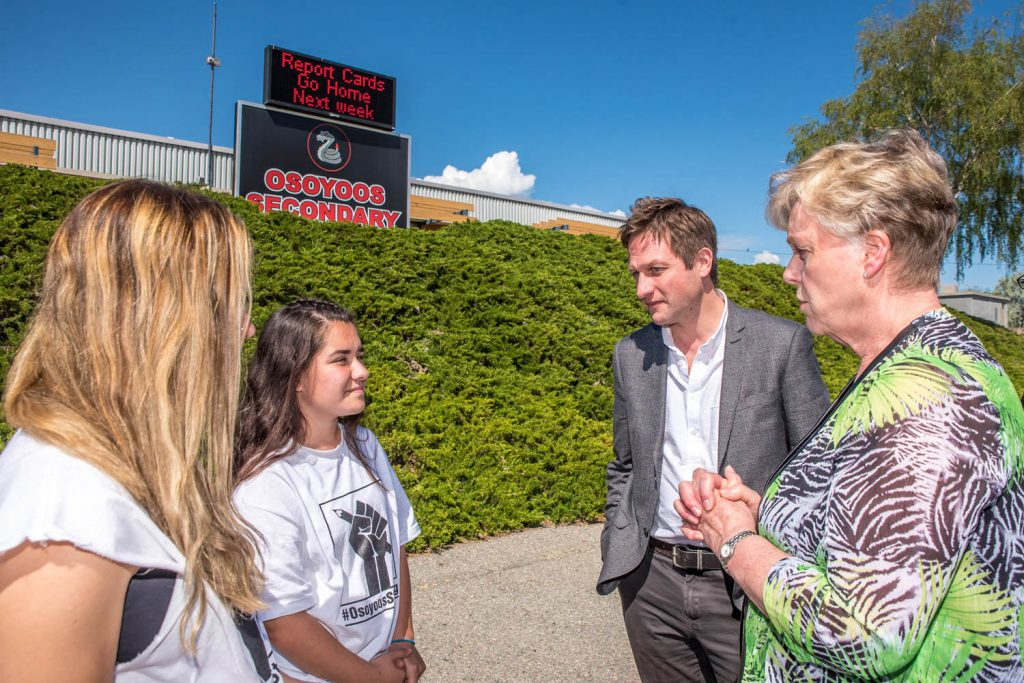 """NDP Education Critic Rob Fleming (second from right) and Mayor Sue McKortoff (right) congratulated Osoyoos Secondary School students Julianna Riznek and Natalia Ibanez for taking the intitiative to create a """"Thank You"""" banner for the Osoyoos community in May. (Richard McGuire photo)"""