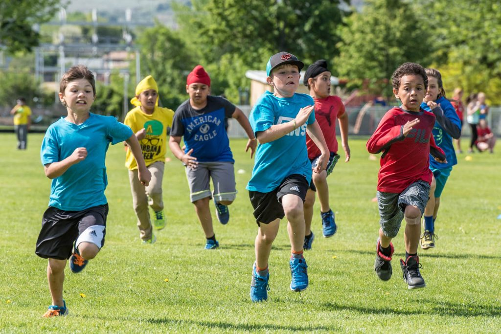 Callum Wallner, Alan Singer and Malcolm Cuthbert moved into the lead in the 80-metre dash at Osoyoos Elementary School's track and field day in May. (Richard McGuire photo)