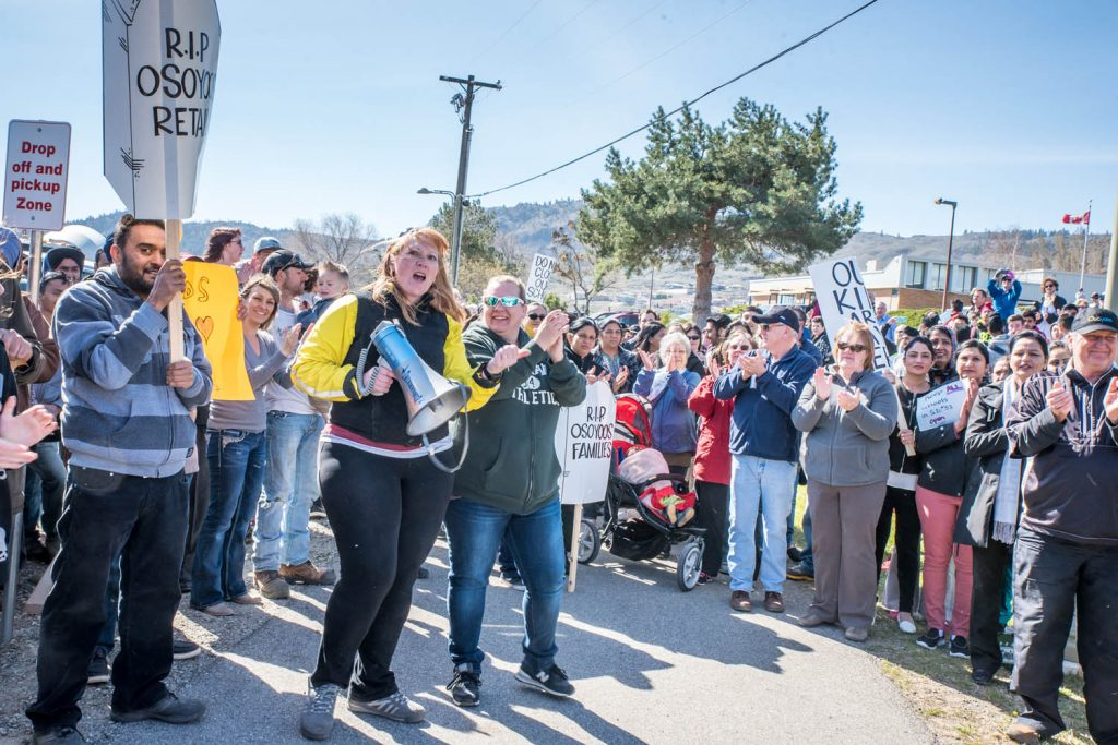 Hundreds of local residents turned out at a rally in March to show their support for keeping Osoyoos schools open. The rally at Osoyoos Secondary School was organized by Brenda Dorosz (with megaphone) and other members of her Save Our Schools (SOS) committee. (Richard McGuire photo)