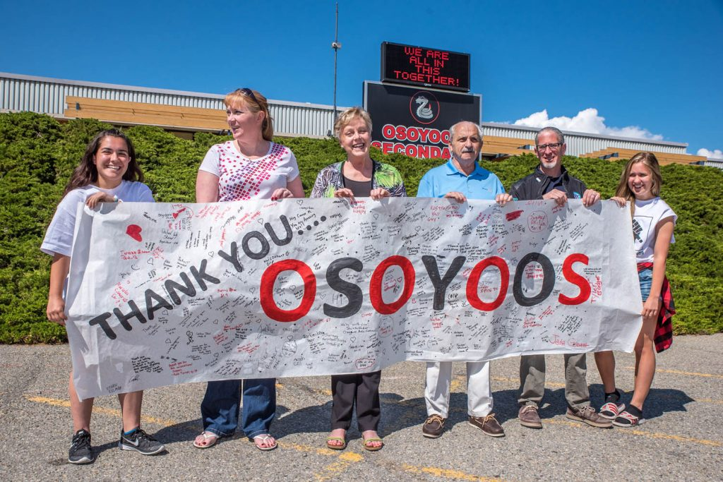 Students of the Osoyoos Secondary School senior girls soccer tean wanted a way to thank the Osoyoos community for its support during the difficult months their school was threatened, so they decided to do a thank you banner, signed by students and others. In May. they presented it to Osoyoos town council for it to be put on display at town hall. Students Natalia Ibanez (left) and Julianna Riznek (right) were organizers. From left are Ibanez; Brenda Dorosz, chair of Save Our Schools committee; Mayor Sue McKortoff; Coun. Jim King; Coun. Mike Campol; and Riznek. (Richard McGuire photo)
