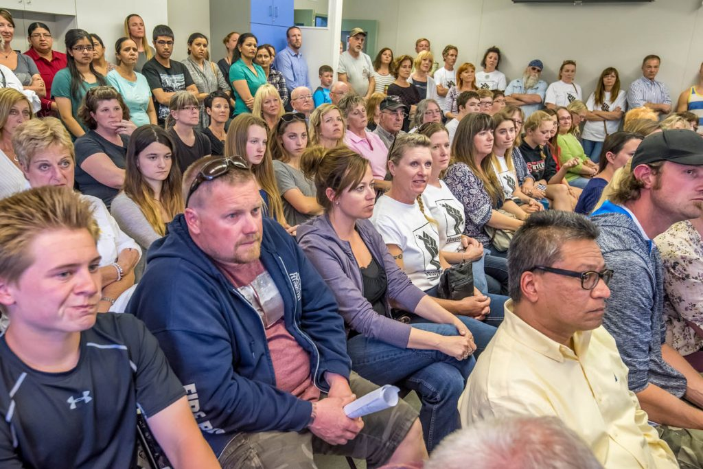 Osoyoos residents packed the School District 53 annex in May as the school board voted 4-3 on a bylaw to close Osoyoos Secondary School. The Town of Osoyoos announced at the meeting that they would be taking the matter to court. (Richard McGuire photo)