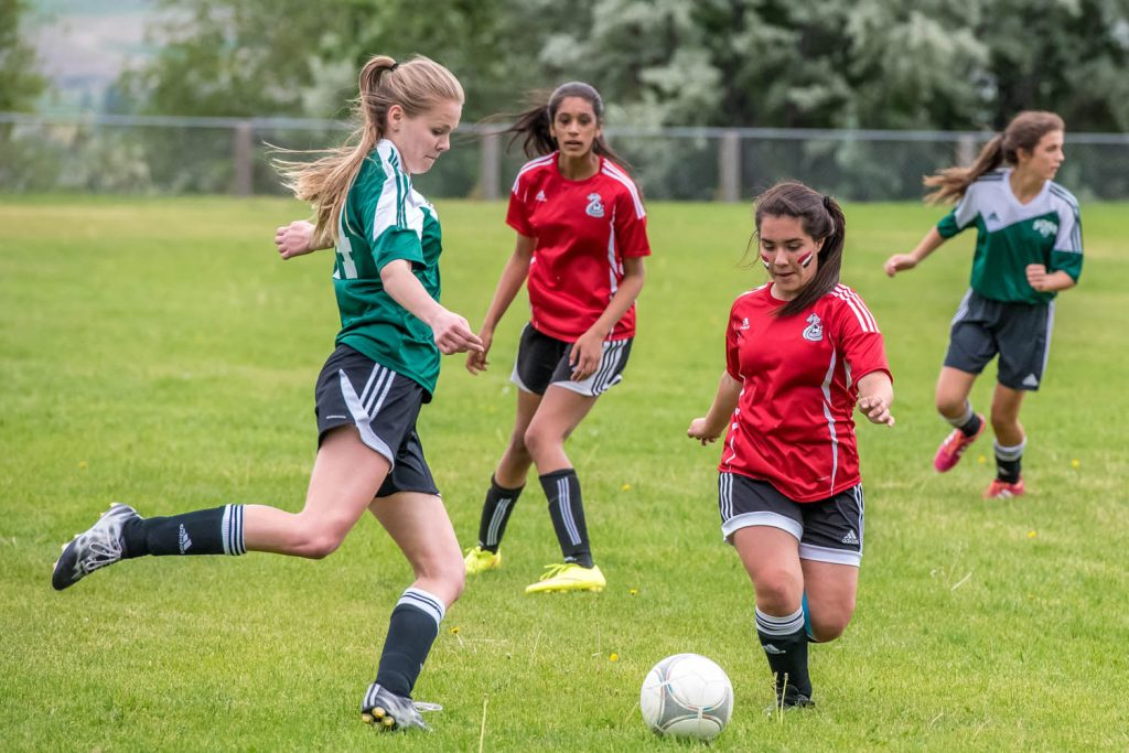 In their last home game of the season, and what was feared would be the last ever at Osoyoos Secondary School, the OSS senior girls soccer team shut out Oliver 4-0. Better that rivalries between the two communities should be played out on the sports field than on the school board. (Richard McGuire photo)